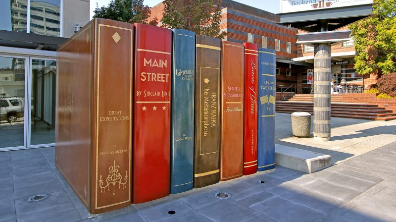 Dylan Works mammoth books hiding a PUD transformer outside Everett's Library Place.